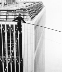Philippe Petit balances as he walks between the World Trade Center